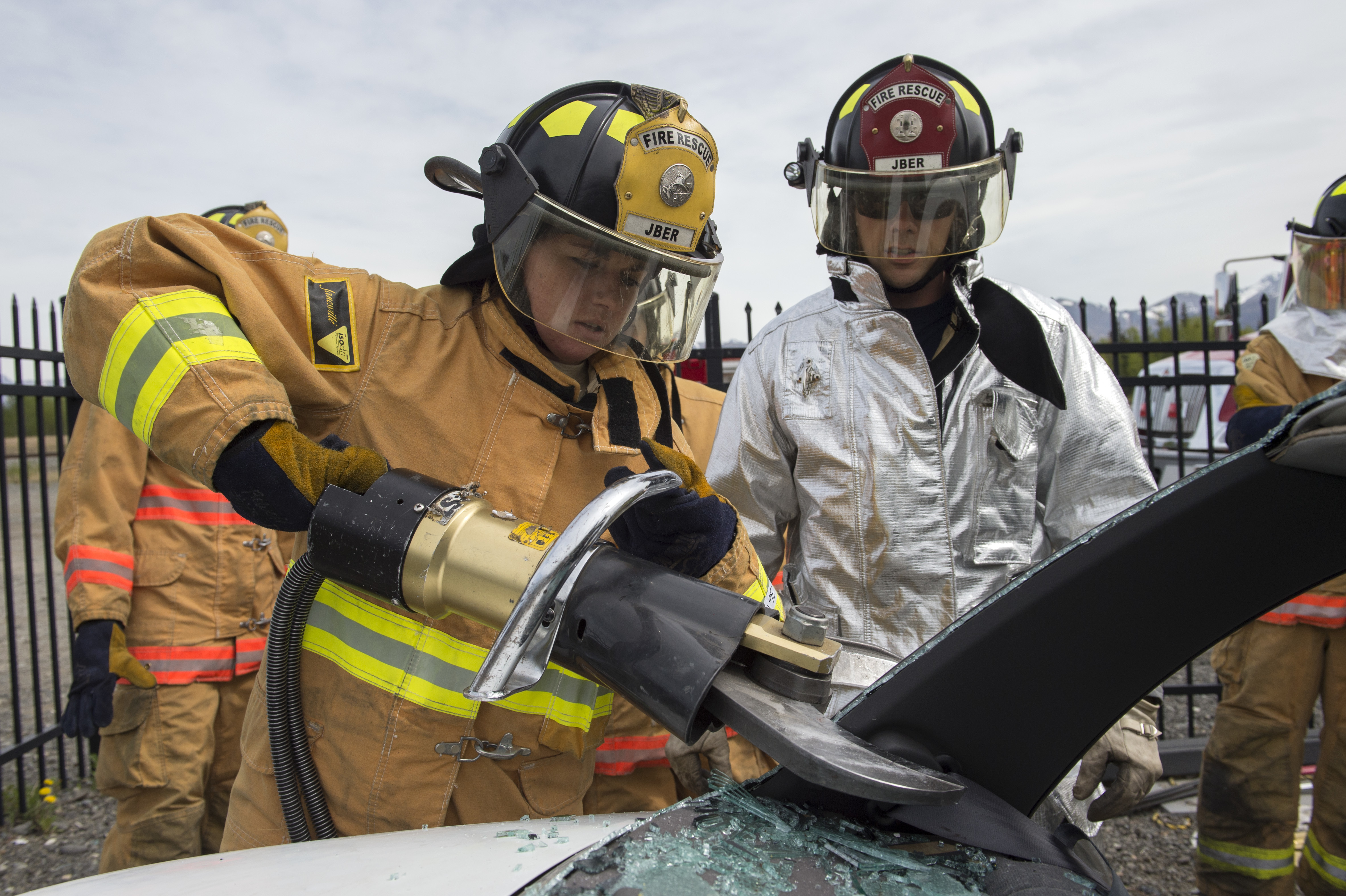 U.S. Air Force Academy cadet Katheryn New, left, a native of Mosca, Colo., operates a hydraulic rescue tool under the supervision of Troy Anthis, a firefighter assigned to the 673rd Civil Engineer Squadron, while conducting rescue training on Joint Base Elmendorf-Richardson, Alaska, May 20, 2015. The training provided the cadets, studying civil engineering, the opportunity to work with Airmen and noncommissioned officers in their field of choice. (U.S. Air Force photo/Alejandro Pena)